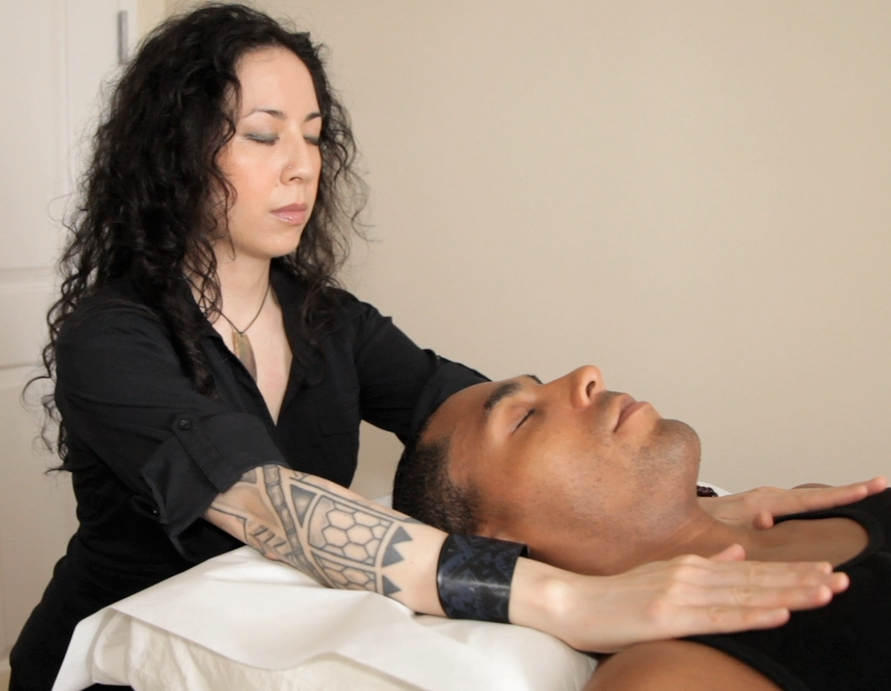 Yours truly performing a Reiki session.