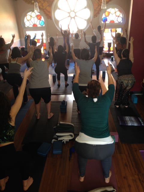 Chia-Ti leading participants through a yoga sequence.