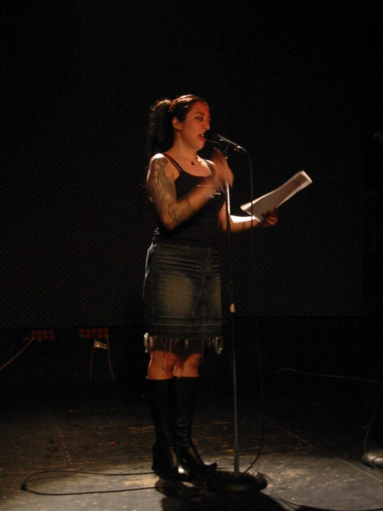 Yours Truly reading at the Bowery Poetry Club back in the day for a Bamboo Girl Benefit. Photo courtesy of the author. All rights reserved.